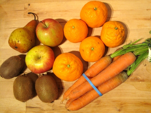 CSA fruits and veggies ready for juicing